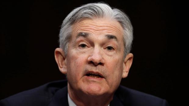 Rupee stays lower as Dollar rallies on Powell testimony