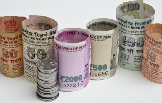 Rupee gains on upbeat inflation and industrial output data