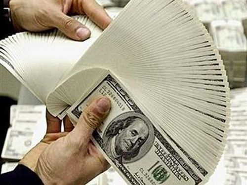 Rupee at over 6-month low on foreign bank Dollar bids