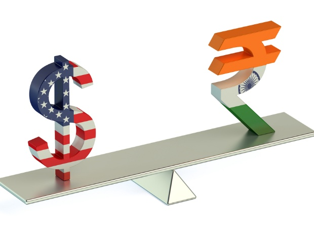 Rupee edges lower as upbeat housing and industrial output data lifted US Dollar