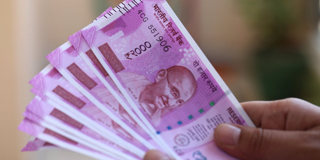 Rupee trading little changed tracking asian peers