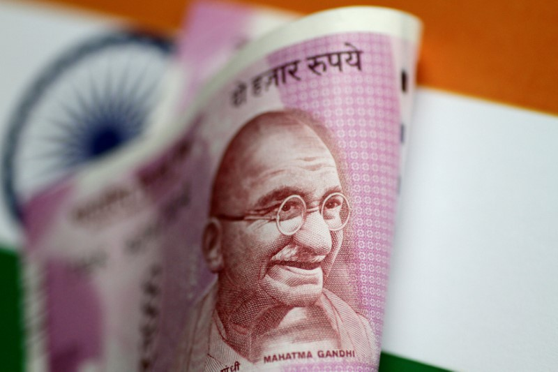 Indian rupee ended higher on heavy greenback sales by private banks