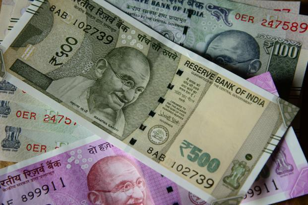 Rupee ends higher at 69.7350 as compared to previous close