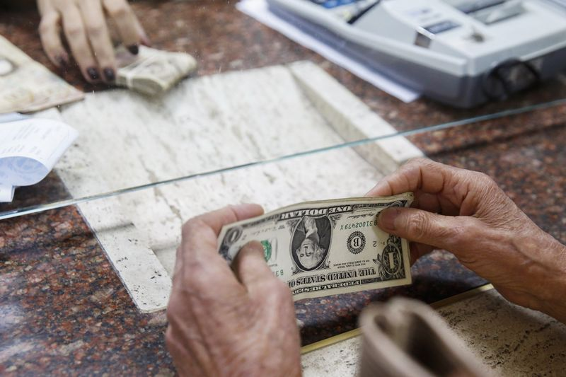 Dollar under pressure after Fed fuels bets on large rate cut
