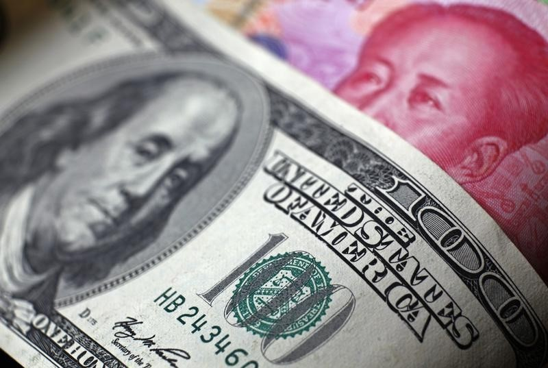 The Chinese yuan inched down against the U.S. Dollar