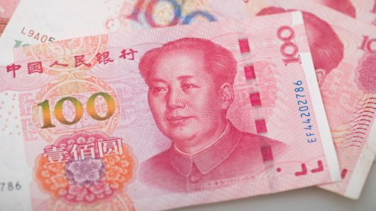 Yuan eases to 2-week low on weaker midpoint fixing, virus concerns