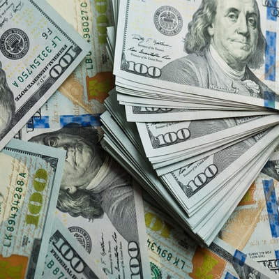 Dollar slips as investors focus on recovery outlook