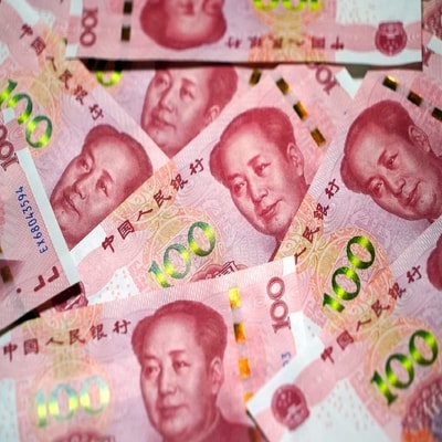 Yuan eases off 3-week high on Sino-U.S. tensions, corporate dollar demand
