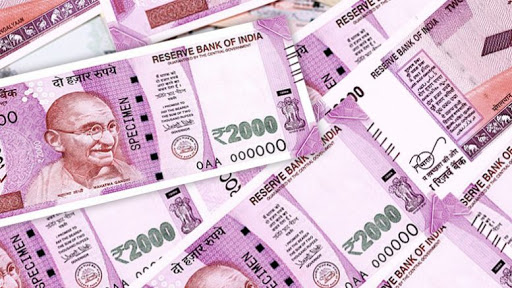 Indian Rupee Closed Lower Amid Foreign Banks' Dollar Purchases